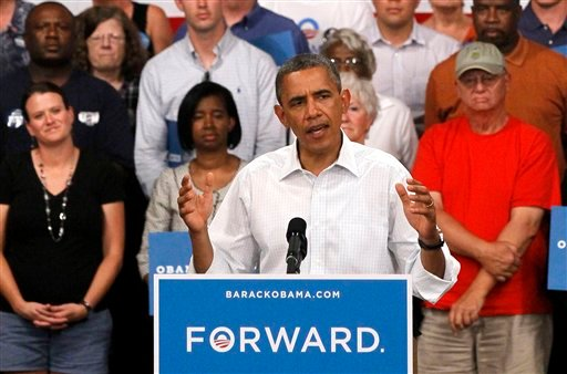 © FILE - In this Aug. 14, 2012 file photo, President Barack Obama speaks during a campaign stop in Marshalltown, Iowa.