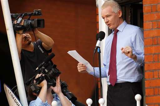 © WikiLeaks founder Julian Assange makes a statement to the media and supporters at a window of Ecuadorian Embassy in central London, Sunday, Aug. 19, 2012.