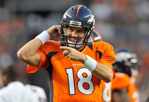 © Denver Broncos quarterback Peyton Manning reacts after his team scored a touchdown in the first half of an NFL football preseason game against the Seattle Seahawks, Saturday, Aug. 18, 2012, in Denver.