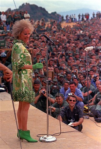 Jan. 6, 1967 file photo: comedian Phyllis Diller performs during the Bob Hope show for American troops at Can Ranh Bay, South Vietnam. Diller  died Aug. 20, 2012, at age 95 in Los Angeles. (AP Photo/File)