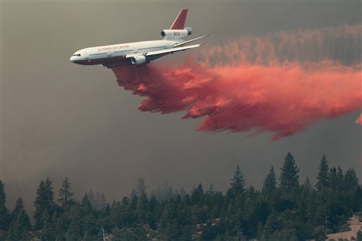 A DC-10 drops fire retardant on the Ponderosa Fire Monday Aug. 20, 2012, near Paynes Creek, Calif. (AP Photo/The Record Searchlight, Andreas Fuhrmann)