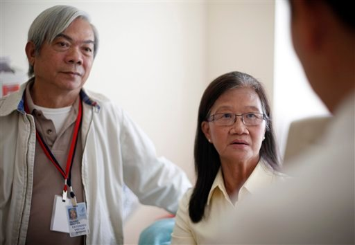 Patient Kim Nguyen, right, and her husband Quang Nguyen are seen at National Institute of Health in Bethesda, Md., Wednesday, Aug. 22, 2012. (AP Photo/Pablo Martinez Monsivais)