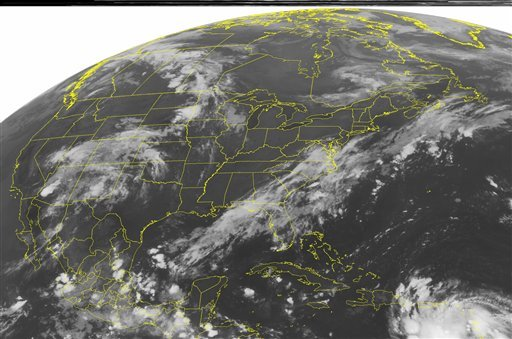 This NOAA satellite image taken Thursday, Aug. 23, 2012 at 1:45 a.m. EDT shows Tropical Storm Isaac spinning over the eastern Caribbean Sea. (AP PHOTO/WEATHER UNDERGROUND)
