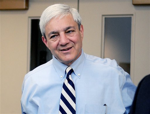 In this July 12, 2012, photo, Penn State President Graham Spanier arrives at the University Park Airport in State College, Pa. (AP Photo/Centre Daily Times, Abby Drey)
