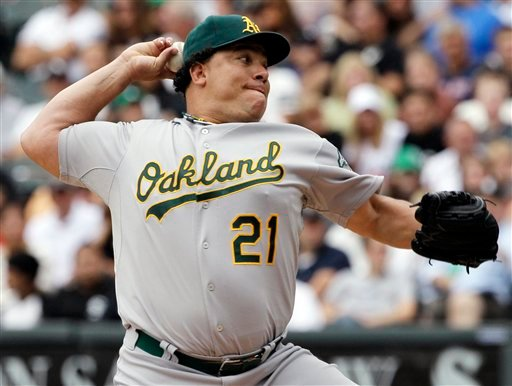 In this Aug. 12, 2012, file photo, Oakland Athletics starter Bartolo Colon throws against the Chicago White Sox during the first inning of a baseball game in Chicago.
