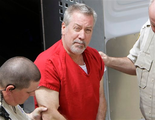 FILE - In this May 8, 2009 file photo, former Bolingbrook, Ill., police sergeant Drew Peterson arrives at the Will County Courthouse in Joliet, Ill. for his arraignment on charges of first-degree murder in the 2004 death of his former wife Kathleen Savio.