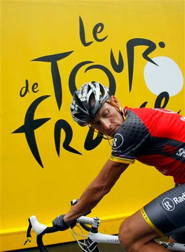 In this July 9, 2010, file photo, Lance Armstrong prepares to take the start of the sixth stage of the Tour de France cycling race over 227.5 kilometers (141.4 miles) with a start in Montargis and finish in Gueugnon, France.