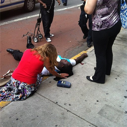 This photo posted to an Instagram account belonging to a person identified as mr_mookie, an eyewitness at the scene, shows a victim of a shooting being tended to by pedestrians outside the Empire State Building in New York.