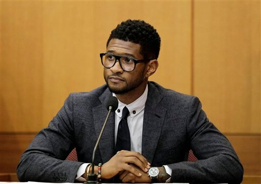 FILE - In this May 22, 2012 file photo, hip-hop artist Usher Raymond takes the witness stand in court in a legal battle with his ex-wife in a custody fight involving their two sons, in Atlanta. (AP Photo/David Goldman, File)