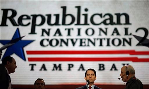 © Wisconsin Gov. Scott Walker, second from right, walks up to the podium for a test in the Tampa Bay Times Forum at the Republican National Convention in Tampa, Fla., on Sunday, Aug. 26, 2012.