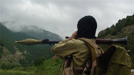 © FILE -- In this Sunday Aug. 5, 2012 file photo, a Pakistani Taliban militant holds a rocket-propelled grenade at the Taliban stronghold of Shawal, in Pakistani tribal region of Waziristan, Pakistan.