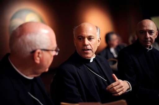 FILE - In this file photo from Friday July 27, 2012, newly appointed Archbishop Salvatore Cordileone, center, speaks with other members of the church during a press conference held at St. Mary's Cathedral in San Francisco. (AP Photo/Michael Short, File)
