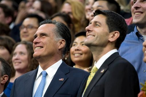 Republican presidential candidate, former Massachusetts Gov. Mitt Romney and his vice presidential running mate Rep. Paul Ryan, R-Wis., pose for photos before a walk through on the stage of the RNC, Aug. 30, 2012, in Tampa, Fla. (AP Photo/Evan Vucci)