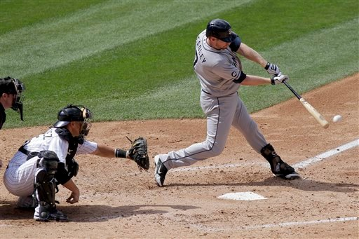 San Diego Padres' Chase Headley, right, hits a single, scoring Alexi Amarista and Chris Denorfia, during the fourth inning of a baseball game against the Colorado Rockies, Sunday, Sept. 2, 2012, in Denver. The Rockies won 11-10. (AP Photo/Barry Gutierrez)