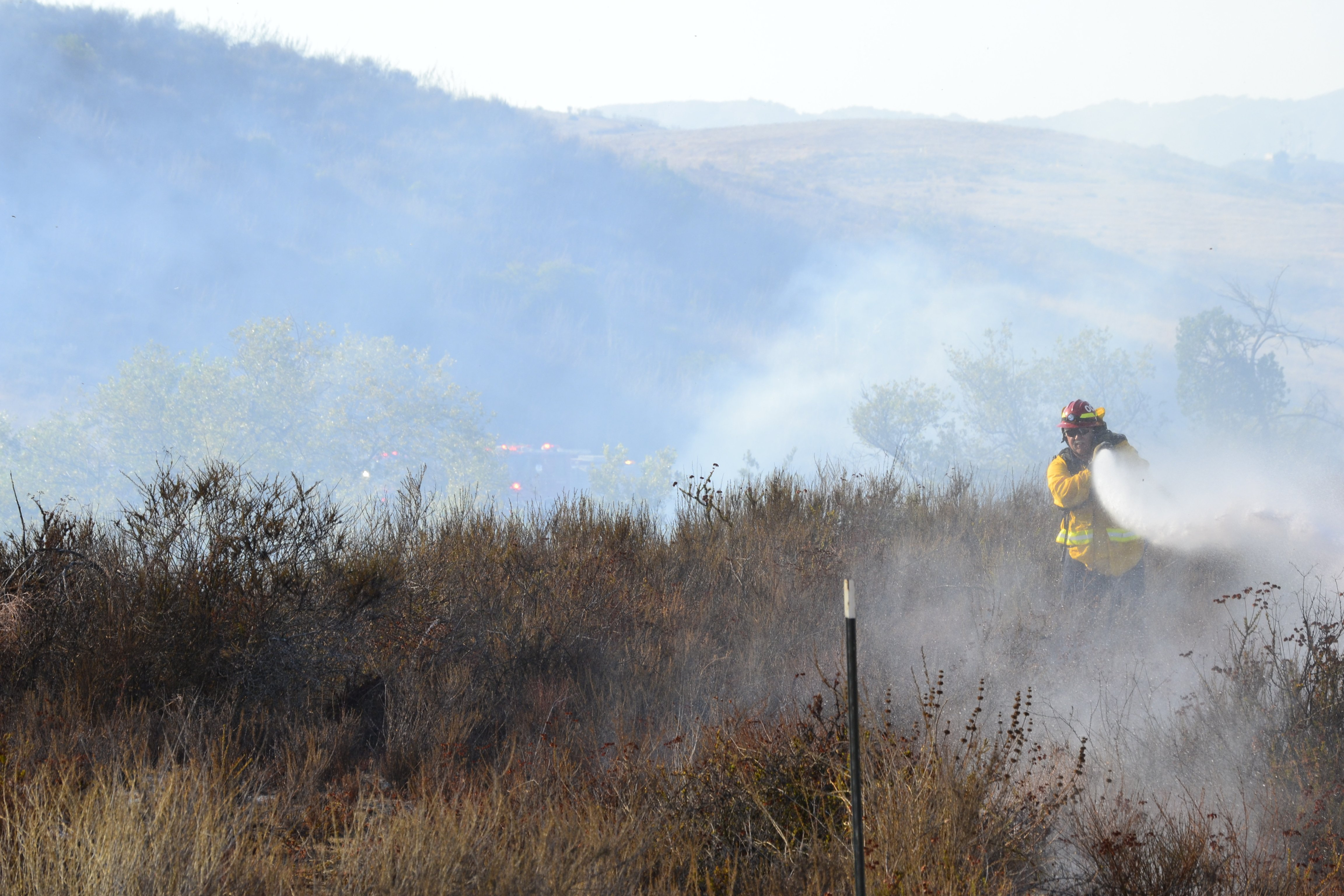 © A fireman fights a brush fire near Camp Pendleton. Photo submitted online by Tiphanie.