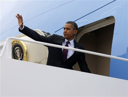 © President Barack Obama waves as he boards Air Force One before his departure from Andrews Air Force Base, Md., Tuesday, Sept., 4, 2012. (AP Photo/Pablo Martinez Monsivais)
