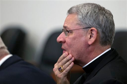 Bishop Robert Finn of the Diocese of Kansas City-St. Joseph appears in court during in a bench trial Thursday, Sept. 6, 2012 at the Jackson County Courthouse in Kansas City, Mo. (AP Photo/The Kansas City Star, Tammy Ljungblad, Pool)
