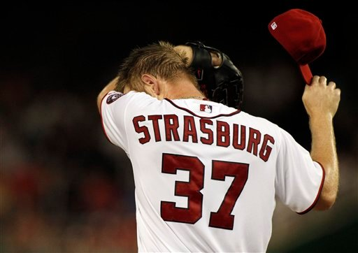 © Washington Nationals starting pitcher Stephen Strasburg wipes his face on the mound during the second inning of a baseball game against the Miami Marlins at Nationals Park, Friday, Sept. 7, 2012, in Washington.
