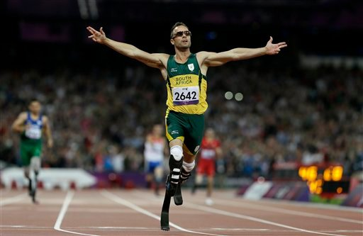 © South Africa's Oscar Pistorius wins gold in the men's 400-meter T44 final at the 2012 Paralympics, Saturday, Sept. 8, 2012, in London. (AP Photo/Kirsty Wigglesworth)