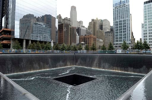 © FILE - In this Sept. 6, 2011 file photo, the World Trade Center North Tower memorial pool at the National September 11 Memorial and Museum is seen against the New York City skyline.