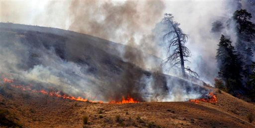 Flames burn at one end of a wildfire Monday, Sept. 10, 2012, near Wenatchee, Wash. (AP Photo/Elaine Thompson)