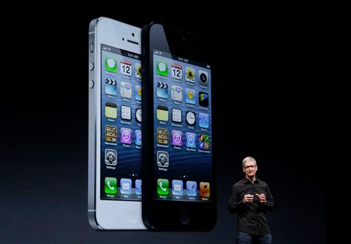 pple CEO Tim Cook speaks in front of an image of the iPhone 5 during an Apple event in San Francisco, Wednesday, Sept. 12, 2012. (AP Photo/Jeff Chiu)