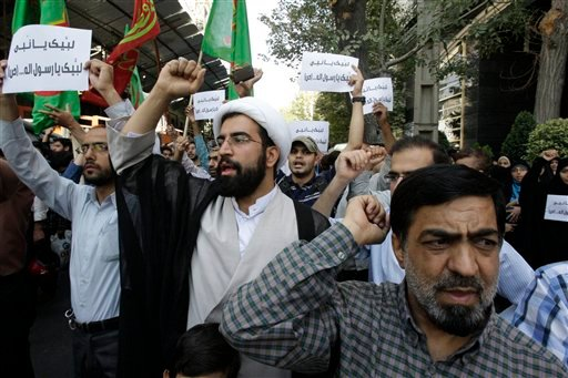Iranian protestors chant slogans during a demonstration against a film ridiculing Islam's Prophet Muhammad, in front of Swiss Embassy in Tehran, which represents US interests in Iran, Thursday, Sept. 13, 2012.