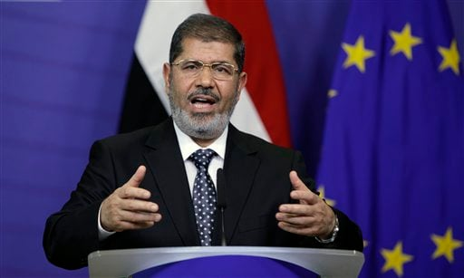 Egyptian President Mohamed Morsi gestures while speaking during a media conference at EU headquarters in Brussels on Thursday, Sept. 13, 2012. This is Egyptian President Mohammed Morsi's first trip to the European Union since being elected president.