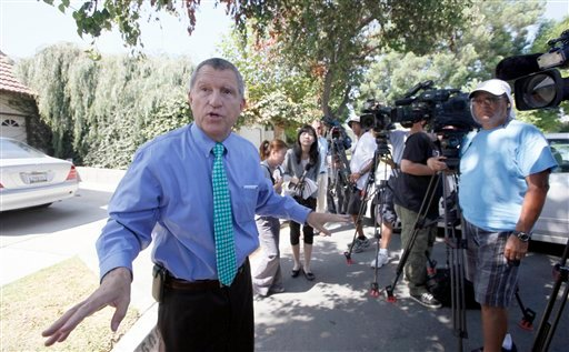 © Los Angeles Sheriff's Department spokesman Steve Whitmore speaks to media outside the home of Nakoula Basseley Nakoula Thursday Sept. 13, 2012 in Cerritos, Calif.