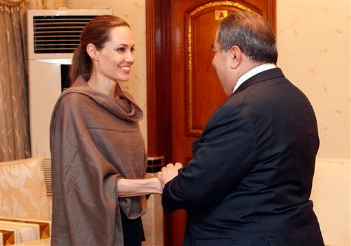 © United Nations High Commissioner for Refugees (UNHCR) special envoy Angelina Jolie, left, shakes hands with Iraqi Foreign Minister Hoshyar Zebari in Baghdad, Iraq, Saturday, Sept. 15.
