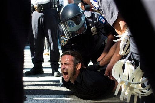 Occupy Wall Street protestor Chris Philips screams as he is arrested near Zuccotti Park, Monday, Sept. 17, 2012, in New York. (AP Photo/John Minchillo)