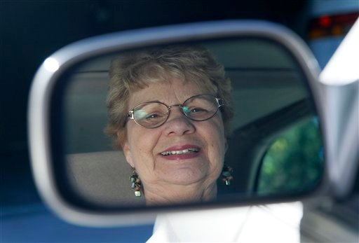 In this photo taken Sept. 12, 2012, Sandy Wiseman is reflected in the rearview mirror in Schaumburg, Ill. Jerry Wiseman and his wife, Sandy, took refresher driving classes to help them stay safe behind the wheel for many more years. (AP Photo)