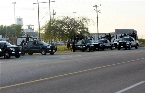 A group of Mexican federal police stand in front of the prison in Piedras Negras, Mexico, Monday Sept. 17, 2012. (AP Photo/Adriana Alvarado)