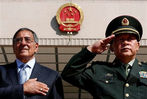 U.S. Defense Secretary Leon Panetta, left, stands at attention during the national anthem next to China's Defense Minister Liang Guanglie at the Bayi Building in Beijing, China Tuesday, Sept. 18, 2012. (AP Photo/Larry Downing, Pool)