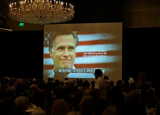 A campaign film is shown before Republican presidential candidate and former Massachusetts Gov. Mitt Romney speaks at a campaign fundraising event at The Grand America in Salt Lake City, Utah, Tuesday, Sept. 18, 2012. (AP Photo/Charles Dharapak)