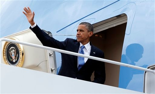President Barack Obama boards Air Force One, Tuesday, Sept. 18, 2012, at Andrews Air Force Base, Md., en route to New York. (AP Photo/Carolyn Kaster)
