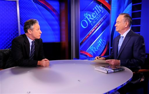 "FILE - This Sept. 22, 2010 file photo shows Comedy Central's Jon Stewart from ""The Daily Show with Jon Stewart,"" left, and and political pundit Bill O'Reilly during an interview for ""The O'Reilly Factor"" on FOX News Channel, in New York. (AP Photo)"