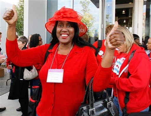 Mary Edmonds, a member of the Chicago Teachers Union's House of Delegates, celebrates after the delegates voted to suspend the strike against the school district Tuesday, Sept. 18, 2012, in Chicago. (AP Photo/Charles Rex Arbogast)