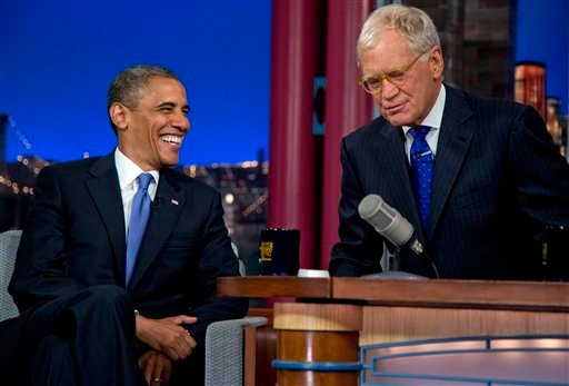 "President Barack Obama talks with David Letterman on the set of the ""Late Show With David Letterman"" at the Ed Sullivan Theater, Tuesday, Sept. 18, 2012, in New York. (AP Photo/Carolyn Kaster)"
