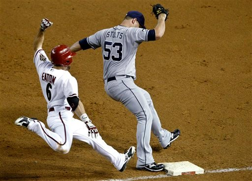 San Diego Padres' Eric Stults (53) beats Arizona Diamondbacks' Adam Eaton (6) to first base for the out in the fourth inning of a baseball game Tuesday, Sept. 18, 2012, in Phoenix.(AP Photo/Ross D. Franklin)
