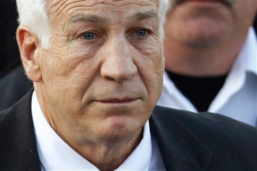 FILE - In this Dec. 13, 2011 file photo, Jerry Sandusky, the former Penn State assistant football coach charged with sexually abusing boys, leaves the Centre County Courthouse in Bellefonte, Pa. (AP Photo/Matt Rourke, File)
