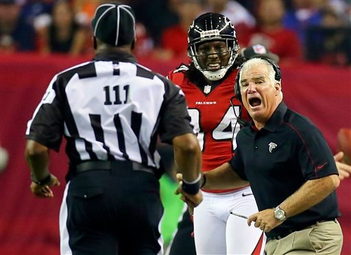 Atlanta Falcons head coach Mike Smith, right, argues for a pass interference call on a play involving wide receiver Roddy White, center, with an official during the second half of their NFL football game against the Denver Broncos, Monday, Sept. 17, 2012.