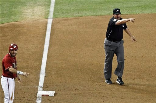 Third base umpire Doug Eddings, right, signals a balk on San Diego Padres' Edinson Volquez as Arizona Diamondbacks' Adam Eaton points at the pitcher as well during the fifth inning of a baseball game Sept. 19, 2012 in Phoenix.(AP Photo/Ross D. Franklin)
