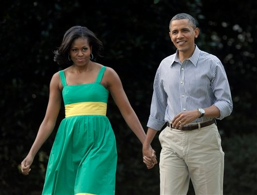 FILE - In this June 27, 2012 file photo, President Barack Obama and his wife, Michelle, arrive at the Congressional picnic on the South Lawn of the White House in Washington. (AP)