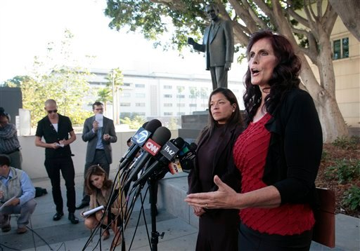 "Cindy Lee Garcia, right, one of the actresses in ""Innocence of Muslims,"" and attorney M. Cris Armenta hold a news conference before a hearing at Los Angeles Superior Court in Los Angeles, Thursday, Sept. 20, 2012."