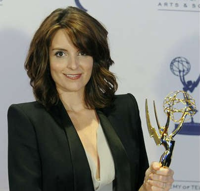 "© In this Sept. 12, 2009 file photo, Tina Fey poses backstage with her Emmy for Outstanding Guest Actress in a Comedy Series for her turn as former Alaska Gov. Sarah Palin on ""Saturday Night Live,"" at the Creative Arts Emmy Awards in Los Angeles."