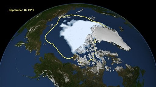 © This Sept. 16, 2012, image released by NASA shows the amount of summer sea ice in the Arctic, at center in white, and the 1979 to 2000 average extent for the day shown, with the yellow line.
