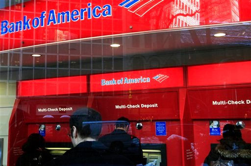 In this Jan. 31, 2011 photo, Bank of America customers use ATM machines in New York. Truly free checking accounts are becoming rarer as banks add more fees to boost their profits. (AP Photo/Mark Lennihan)