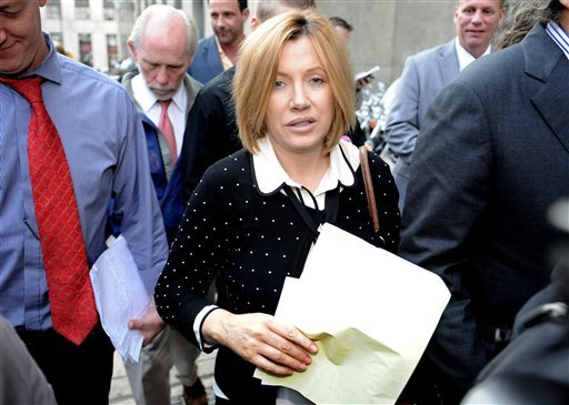 Anna Gristina exits Manhattan criminal court, Tuesday, Sept. 25, 2012, in New York. (AP Photo/ Louis Lanzano)