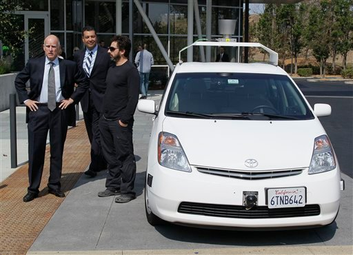 From left, California Gov. Edmund G Brown Jr., state Senator Alex Padilla and Google co-founder Sergey Brin stand by a driverless car they arrived in at Google headquarters in Mountain View, Calif., Tuesday, Sept. 25, 2012. (AP Photo/Eric Risberg)